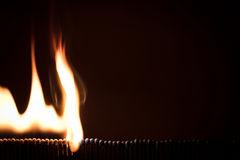 Lots of matchsticks burning with a domino effect, black backgrou. Lots of matchsticks burning with a domino effect, fire with black background Stock Photos