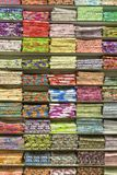 Material stacked on shelves. Lots of material folded and stacked on shelves Stock Image