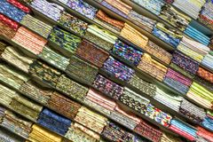 Material stacked on shelves. Lots of material folded and stacked on shelves Stock Photography