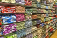 Material stacked on shelves. Lots of material folded and stacked on shelves Royalty Free Stock Photography