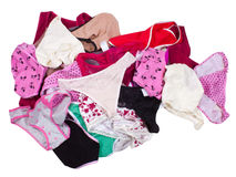 Lots of messy colorful clothes isolated on white Stock Image