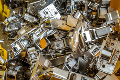 Lots of metal parts and screws in the factory Royalty Free Stock Images