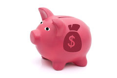 Lots of Money. A pink piggy bank with a money bag on a white background, Lots of Money Stock Photography