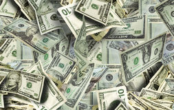 Lots of Money. Multiple denominations of american bills pile high Stock Photos