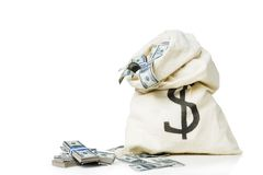 Bag full of money  in a white background Royalty Free Stock Photography