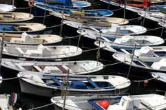 Lots of moored boats. Full frame shot of small white boats all moored together in rows side by side Royalty Free Stock Photos