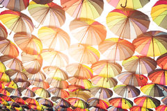 Lots of multi colored umbrellas. Umbrellas and sunlight. Bright palette of joy. Colors that cheer you up Stock Images