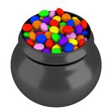 Lots of multicolored candies in a pot isolated. On white background Royalty Free Stock Image