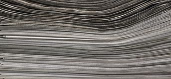 Lots of newspapers. Full frame abstract stacked paper background Stock Photography
