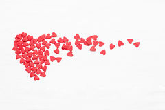 Lots Of Little Red Hearts Flying On White Background.