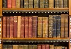 Lots of old books in a library Royalty Free Stock Photos