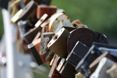 Lots of old rust with wedding locks Royalty Free Stock Photos