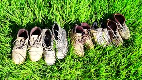 Old Shoes on the grass stock footage