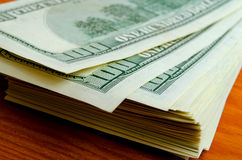 Lots of one hundred of dollar bills. Stock Photos