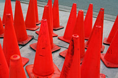 Lots of orange traffic cones. Lots of vivid orange traffic cones on a sidewalk Stock Image