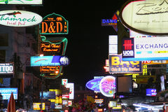 Lots of outdoor advertising. Khao San Road in Bangkok. Touristic street in the capital of Thailand Royalty Free Stock Images