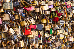 Lots of Padlocks On Bridge over the Seine, Paris France, symbolizing Love and Trust Royalty Free Stock Image
