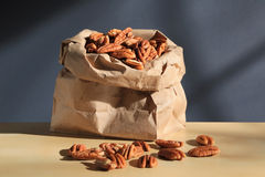 Lots of pecans in paper bag Royalty Free Stock Image