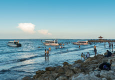 Lots of people on the beach in Sanur Royalty Free Stock Image