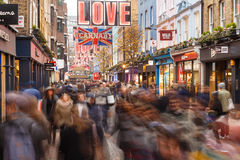Lots of people Christmas shopping on Carnaby Street, London. Stock Image