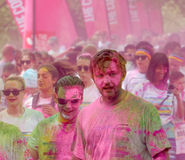 Lots of people covered with pink color powder Royalty Free Stock Photo