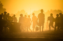 Lots of people in the dust Royalty Free Stock Image