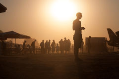 Lots of people in the dust Stock Photography