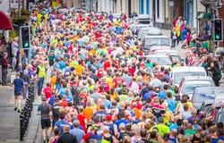 Lots of people running. Fun runners, lots of colourful people road race running.  Similar to London, New York, Boston marathon.  Race the train, Tywyn, Wales 19 Stock Photo