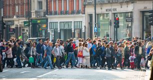 Lots of people, tourists, Londoners shoppers crossing the Regent street. Populated city concept. London, UK Royalty Free Stock Photography