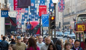 Lots of people, tourists, Londoners shoppers crossing the Regent street. Populated city concept. London, UK Royalty Free Stock Photos
