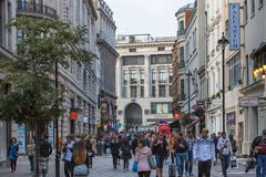 Lots of people, tourists, Londoners shoppers crossing the Regent street. Populated city concept. London, UK. London, UK - August 24, 2016: Lots of people Royalty Free Stock Photo