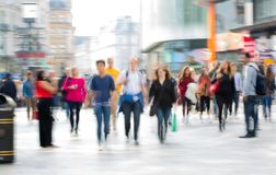 Lots of people, tourists and Londoners walking via Leicester square. London, UK stock photography