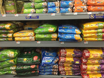 Lots of pet food on shelves selling Royalty Free Stock Images