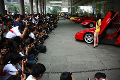 Lots of Photographers. Jakarta, July 25, 2009. In Ferrari Heritage Photo Competition 2009, Pacific Place, Jakarta, numerous photographers photographing female stock photos