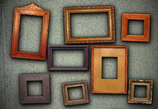 Lots of picture frames hung on green wall Royalty Free Stock Image
