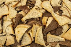 Lots of pieces of wheat and rye bread close-up texture stock images