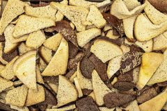 Lots of pieces of wheat and rye bread close-up texture royalty free stock images