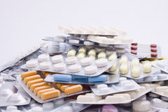 Lots of pills. Isolated on white background Stock Photography