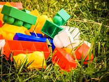 Lots of plastic toy on the grass Stock Photos