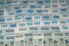 A lots of polish currency banknotes as a background. Stock Photos