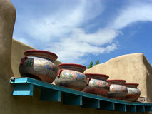 Lots of Pots. Old clay pots on the roof of an adobe building in New Mexico Royalty Free Stock Images
