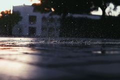 Lots of rain droplets hitting the ground made of bricks royalty free stock photos