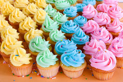 Lots of rainbow cupcakes Royalty Free Stock Images