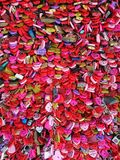 Lots of red hearts showing love. Heart-shaped locks with messages showing love on the wall in a red romantic atmosphere stock photo
