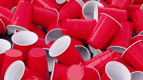 Lots of Red Plastic Cups. Big pile waste of disposable dishes.