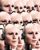 Lots Of Robo Women 3. An image of lots of heads of technologically robotic women, it would make a interesting background Stock Photos