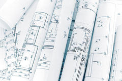 Lots of rolls floor plan drawings on architects workspace. Lots of rolls floor plan drawings on architects workplace Stock Photo