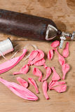 Lots of rose quartz balloons laying on wood table background. Top wiev Royalty Free Stock Photo