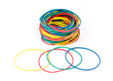 Lots of rubber bands of red, blue, yellow and green colors. Royalty Free Stock Images