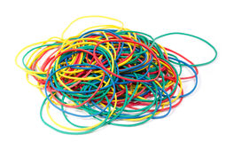 Lots of rubber bands of red, blue, yellow and green colors. Royalty Free Stock Photo